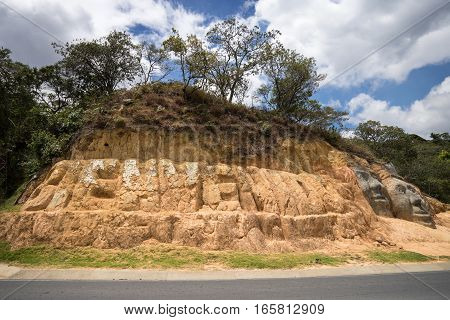 roadside welcome sign carved into the hill in Silvia Colombia
