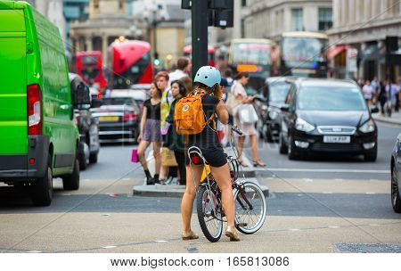 London, UK - August 24, 2016: Cycler in Oxford street waiting on traffic light to make a move.