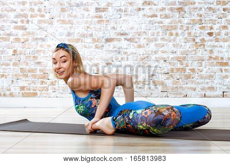 Young Beautiful Woman Practicing Yoga Doing Excercise On Brick Wall Background