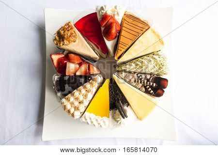 Topdown View Of Cakes, Strawberry, Cheese, Chocolate, Blue Berry, Coffee Cakes