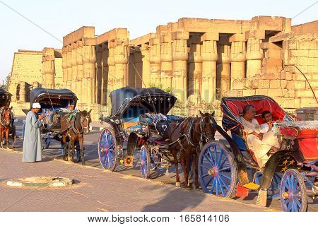LUXOR, EGYPT - NOVEMBER 4, 2011: Tourist Caleches (horse carriages) outside Luxor temple