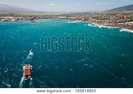 Aerial view of Maui coast line with barge on the water