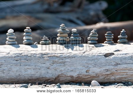 Stacks of rocks of driftwood log zen