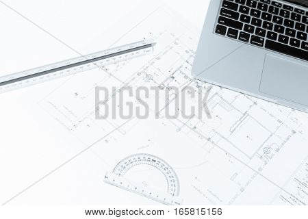 Drawing Rulers, And Notebook Over House Construction Blueprint With Blue Tone Effect