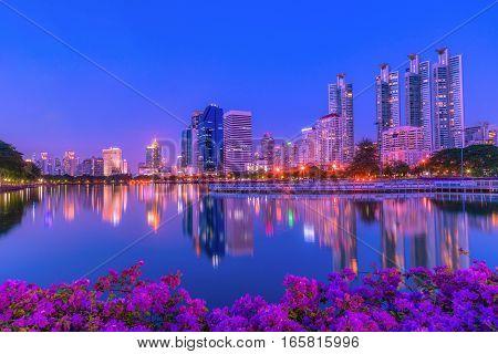 Cityscape image of Benchakitti Park at twilight time in Bangkok Thailand.