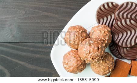 Biscuits and chocolate on white plate ,Dessert background