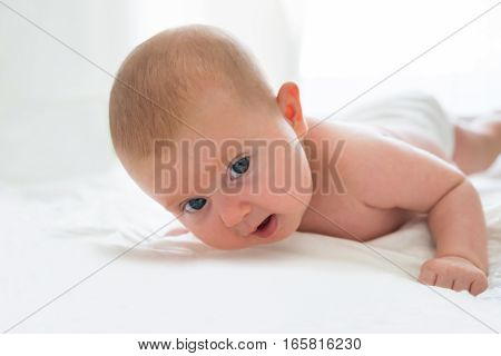 Photo Of An Innocent Baby Playing In Bed