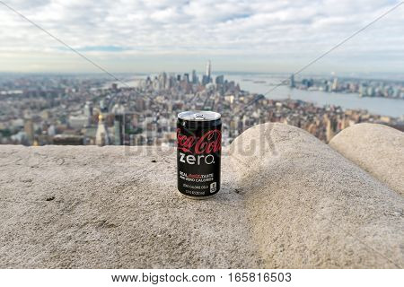 NEW YORK USA - SEPTEMBER 27 2013: Zero Coca-Cola can on a background of Manhattan from the observation deck