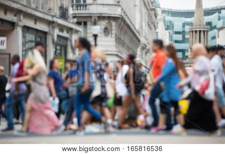 Regent street with lots of walking people crossing the road. Blurred image for background