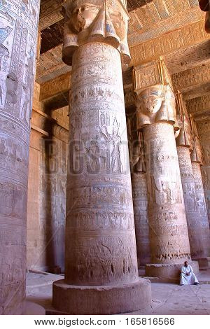 DENDERA, EGYPT - NOVEMBER 2, 2011: The huge pillars and beautiful ceiling inside Dendera temple dedicated to Hathor goddess