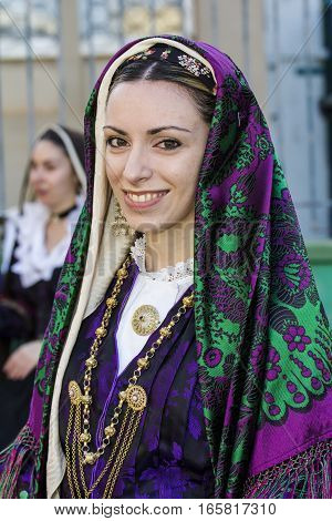 CAGLIARI, ITALY - May 1, 2016: 360 Feast of Saint Efisio - Sardinia - portrait of a beautiful smiling girl in traditional Sardinian costume