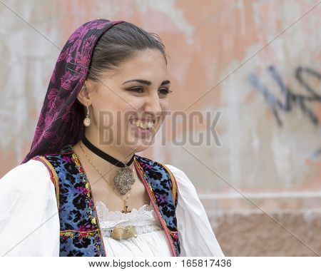 CAGLIARI, ITALY - May 1, 2014: 358 Religious Procession of Sant'Efisio - Sardinia - portrait of a beautiful smiling girl in traditional Sardinian costume