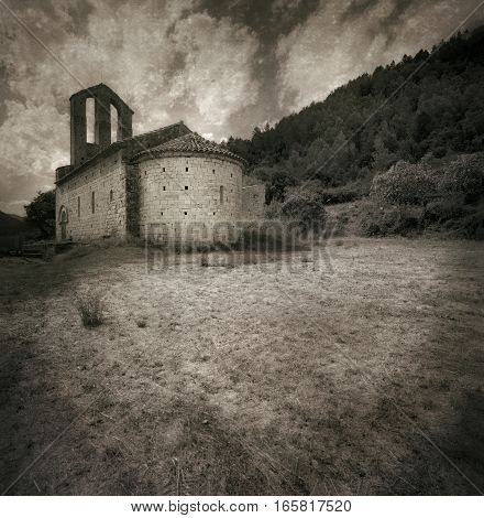 Black and white photo film shot. Romanic hermitage from XII century up on a hill Light sepia tone