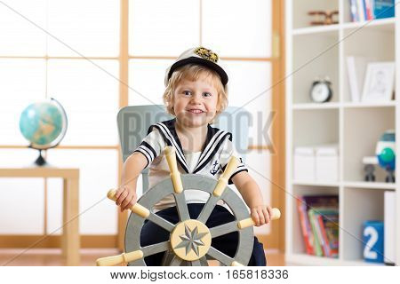 Child toddler boy in sailor hat - adventure and travel concept