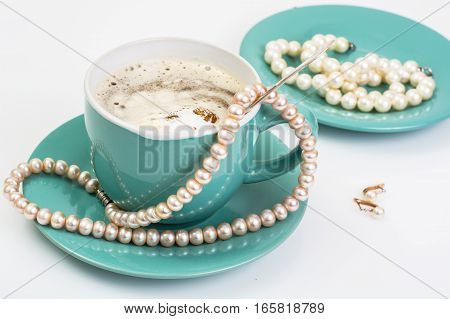 Pearl jewelry as a gift on Valentine's Day. Studio Photo