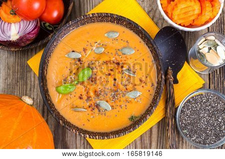 Vegetarian sauce of carrots, zucchini and squash with seeds of chia. Studio Photo