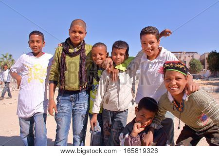 LUXOR, EGYPT - NOVEMBER 6, 2011: Seven young Egyptian boys posing on the East bank of the Nile