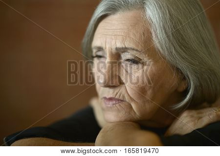 portrait of tired senior woman at home, close up
