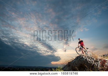Cross Country Biker Relaxing On The Top Of The Mountain