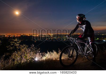 Cyclist With Mountain Bike On Top Of The Hill