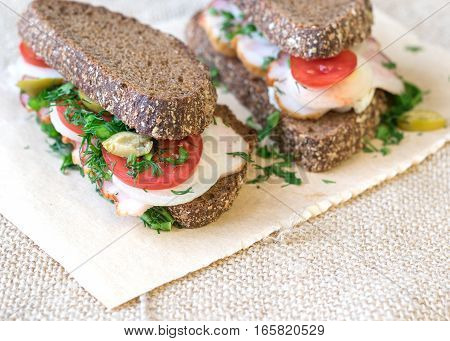 Fresh Sandwich On A Wooden Table With A Piece Of Burlap.