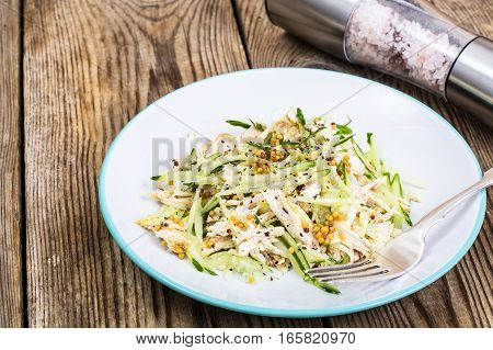 Salad with cucumber, chicken and mustard. Studio Photo