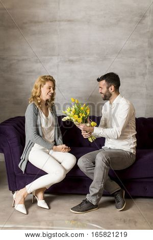 Loving Couple With Bouquet Of Yellow Tulips