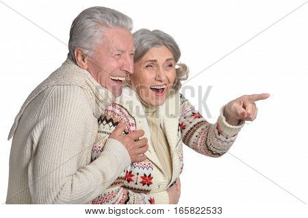 smiling mature couple, posing against white background