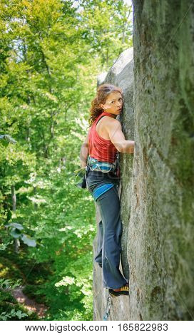 Beautiful Woman Climber Climbing Steep Rock With Rope