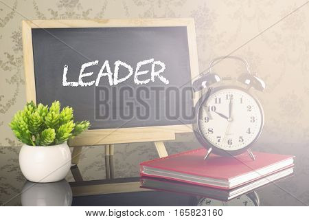 Leader on blackboard with clock and flare