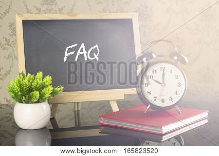 Faq on blackboard with clock and flare