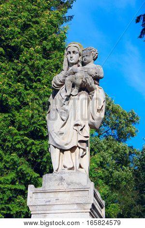 Kachanivka Chernihiv region / Ukraine. 01 October 2016: Statue of mother with her child in Lychakiv Cemetery in Lviv.01 October 2016 in Kachanivka Chernihiv region / Ukraine.