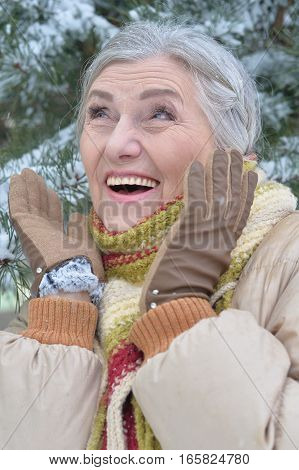 happy mature woman posing outdoors in winter