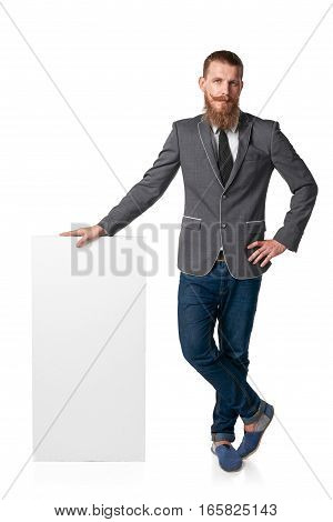 Hipster man with beard and mustashes standing in full length with blank banner
