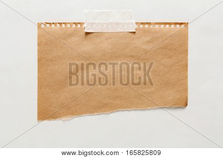 old craft wrapping paper piece isolated on white background. Aged brown kraft sheet with copy space