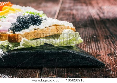 Snack of farmer cheese sandwiches variety. Colorful fresh tops