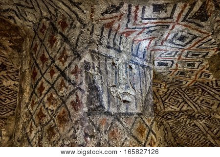 ancient paintings in underground pre-columbian grave in Tierradentro Colombia