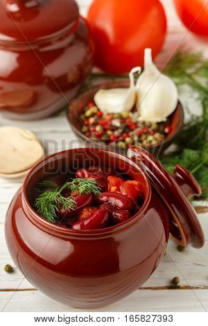 Stewed Red Beans With Tomatoes And Garlic In A Ceramic Pot. Vegetarian Dish. Selective Focus