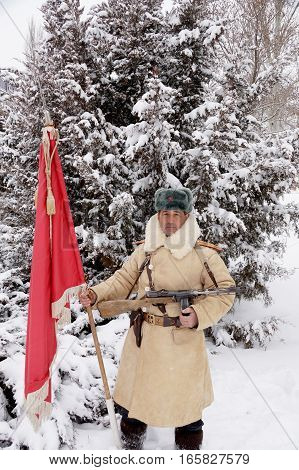 Officer the defender of Stalingrad in winter regimentals with the Red banner