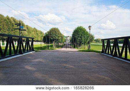 Lantern In Park Next To A Wooden Bridge