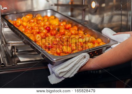 professional Baked sweet potatoes making oven cooking. stock photo