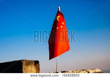China Flag Waving On The Great Wall Of China