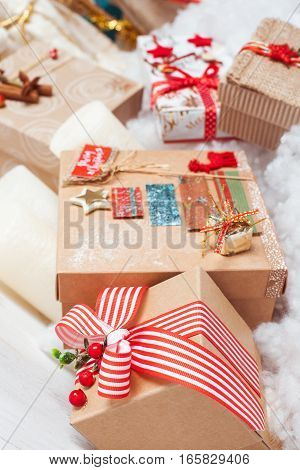plenty of gift red and Kraft boxes. Christmas gifts near Christmas tree