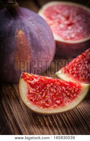 Sliced Figs On A Wooden Table. Top View.