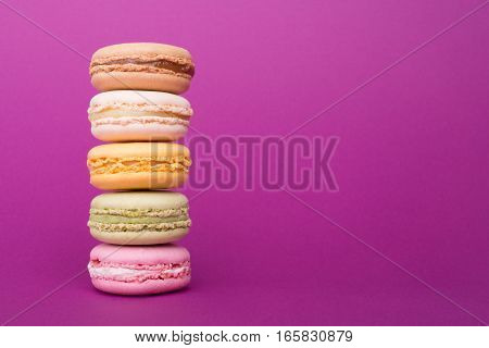 Colorful Macaroons Tower On Violet Background With Copy Space