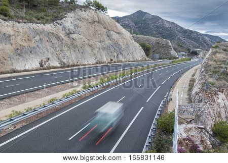 Movement of vehicles on freeway. Sun Coast on winter Nerja Malaga Spain