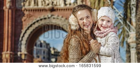 Mother And Child Near Arc De Triomf In Barcelona Hugging