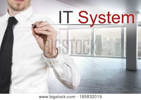 businessman in modern empty office writing it system in the air