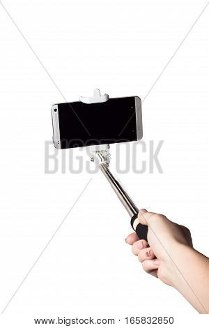 Woman hand hold monopod with mobile phone isolated white clipping path inside