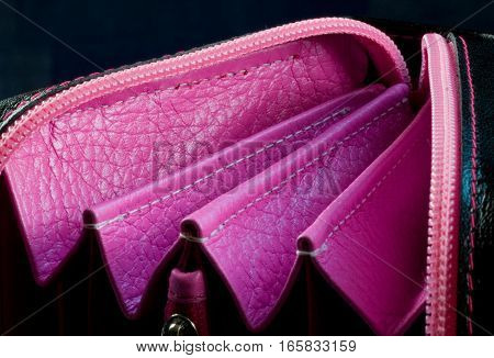 pink folds of a leather purse closeup
